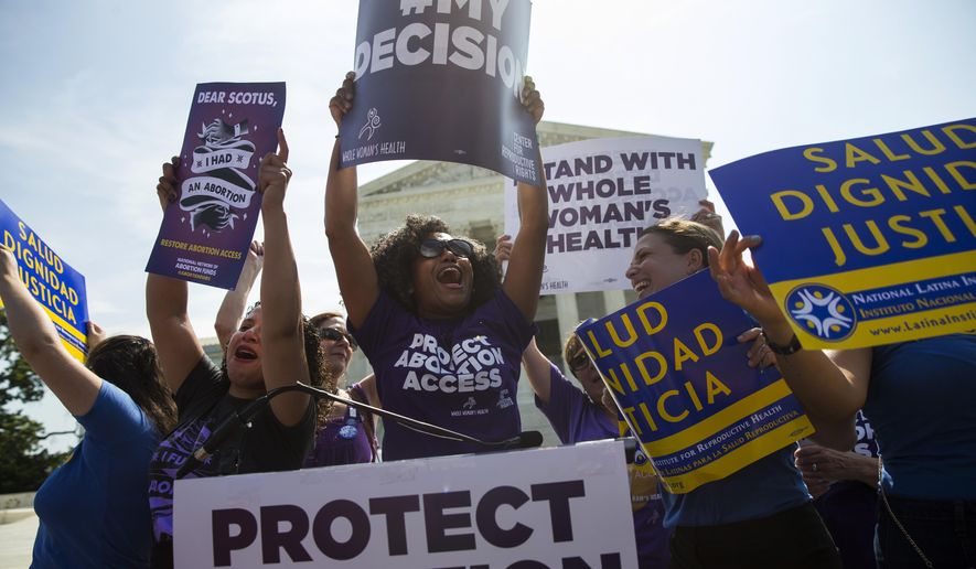 FILE - June 27, 2016 file photo pro-abortion rights activists celebrate during a rally at the Supreme Court in Washington. The tens of thousands of women flocking to Washington for a march on the day after Donald Trump's inauguration come packing a multitude of agendas, but are united in their loathing for Trump.  (AP Photo/Evan Vucci, File)