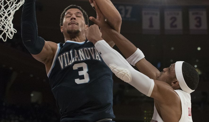 St. John's guard Marcus LoVett, right, stops Villanova guard Josh Hart (3) from scoring during the first half of an NCAA college basketball game, Saturday, Jan. 14, 2017, at Madison Square Garden in New York. (AP Photo/Mary Altaffer)