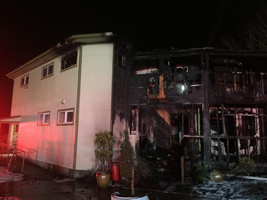 This photo provided by Bellevue, Wash., Fire Department shows damage to the Islamic Center of the Eastside after a fire  in Bellevue, Wash., on Saturday, Jan. 14, 2017.  Police say a man is in custody after a suspicious fire severely damaged the mosque overnight.  Authorities say that as firefighters doused the flames, police found a 37-year-old man near the building and arrested him for investigation of arson. Police spokesman Seth Tyler says investigators believe the man is the sole suspect. His name was not immediately released. The mosque was unoccupied at the time and no injuries were reported. (Bellevue, Wash., Fire Department via AP)