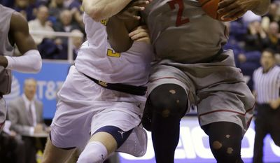 California's Grant Mullins, left, and Washington State's Ike Iroegbu fight for the ball in the first half of an NCAA college basketball game Saturday, Jan. 14, 2017, in Berkeley, Calif. (AP Photo/Ben Margot)