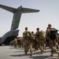 Bringing all but about 15,000 troops home from wars in Iraq and Afghanistan is one of President Obama's proudest achievements, although the move created an opening for terrorists. (Associated Press)