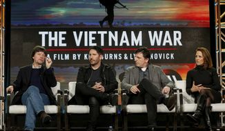 "Ken Burns, from left, Trent Reznor, Atticus Ross and Lynn Novick speak at PBS' ""The Vietnam War"" panel at the 2017 Television Critics Association press tour on Sunday, Jan. 15, 2017, in Pasadena, Calif. (Photo by Willy Sanjuan/Invision/AP)"