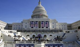 The U.S. Capitol looms over a stage during a rehearsal of President-elect Donald Trump's swearing-in ceremony, Sunday, Jan. 15, 2017, in Washington. (AP Photo/Patrick Semansky)