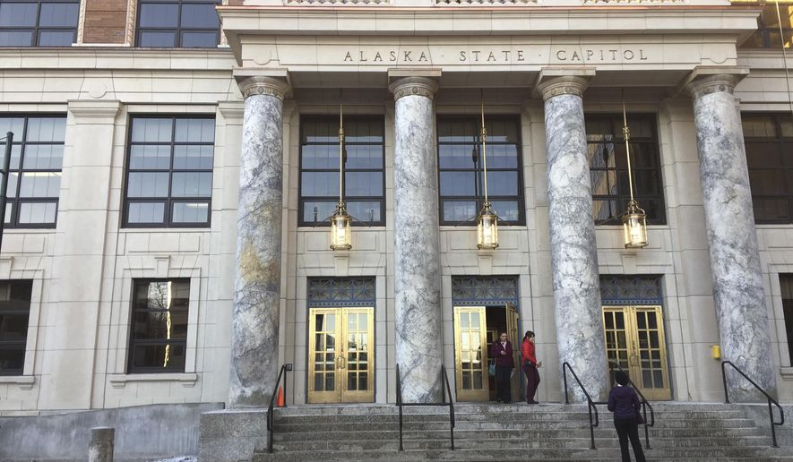 In this photo taken Jan. 3, 2017, people come and go at the Alaska Capitol in Juneau, Alaska. A new legislative session begins Tuesday, Jan. 17, and addressing the state's multibillion-dollar budget deficit is expected to be a top priority for lawmakers. (AP Photo/Becky Bohrer)