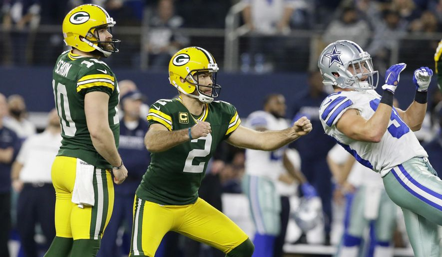 Green Bay Packers kicker Mason Crosby (2) watches his 51-yard field goal to win the game as time expires during the second half of an NFL divisional playoff football game against the Dallas Cowboys Sunday, Jan. 15, 2017, in Arlington, Texas. The Packers won 34-31. (AP Photo/LM Otero)