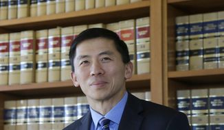 California Supreme Court Justice Goodwin Liu is interviewed in his office in San Francisco, Friday, Jan. 13, 2017. A new study co-authored by Liu, a prominent Asian American judge, finds Asian Americans are well-represented among the nation's attorneys, but still missing from leadership positions in the legal profession. (AP Photo/Jeff Chiu)