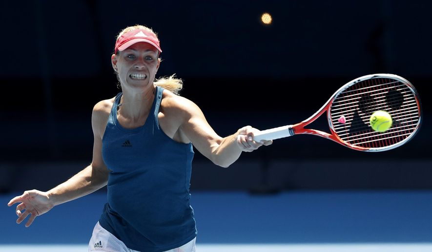 Germany's Angelique Kerber makes a forehand return during a practice session ahead of the Australian Open tennis championships in Melbourne, Australia, Sunday, Jan. 15, 2017. (AP Photo/Kin Cheung )