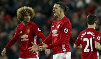 Manchester United's Zlatan Ibrahimovic, centre, celebrates scoring his side's first goal during the English Premier League soccer match between Manchester United and Liverpool at Old Trafford stadium in Manchester, England, Sunday, Jan. 15, 2017. (AP Photo/Dave Thompson)
