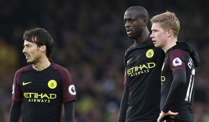 From left, Manchester City's David Silva , Yaya Toure and Kevin De Bruyne  react after Everton scored a second goal, during the English Premier League soccer match between Everton and Manchester City at Goodison Park, in Liverpool, England, Sunday Jan. 15, 2017. (Peter Byrne/PA via AP)