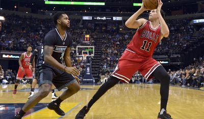 Chicago Bulls forward Doug McDermott (11) turns to shoot against Memphis Grizzlies guard Troy Daniels (30) in the second half of an NBA basketball game Sunday, Jan. 15, 2017, in Memphis, Tenn. (AP Photo/Brandon Dill)