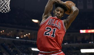 Chicago Bulls forward Jimmy Butler (21) grabs a rebound in the first half of an NBA basketball game against the Memphis Grizzlies Sunday, Jan. 15, 2017, in Memphis, Tenn. (AP Photo/Brandon Dill)