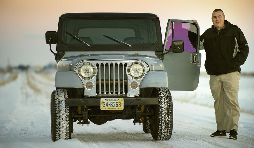 The electric-powered CJ-7 Jeep Adam Verhage built with his father Carroll, seen in a Jan. 5, 2017 photo, doesn't sit in a garage in Geneva awaiting its next car show - it's his daily driver. (Eric Gregory/The Journal-Star via AP)