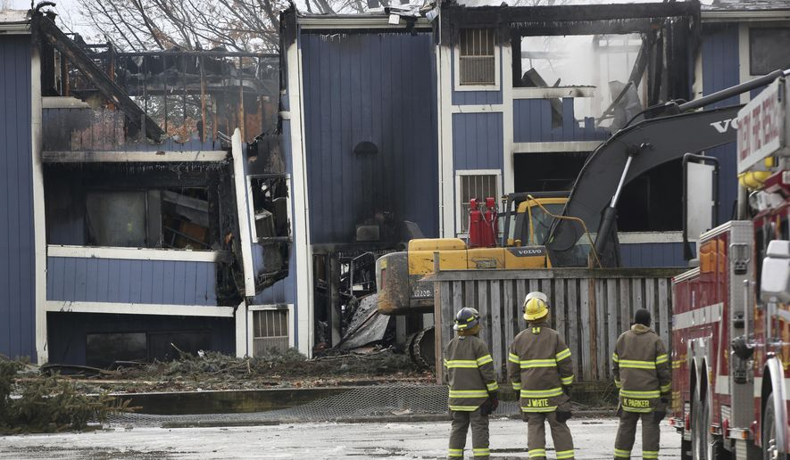 Toledo firefighters evaluate a complex where a deadly fire broke out about 4 a.m. at the Woodlands Apartments complex in the 2400 block of Cheyenne Blvd. off of Heatherdowns Blvd. Several people were killed in the fire, according to Toledo Fire Chief Luis Santiago.(Katie Rausch /The Blade via AP)