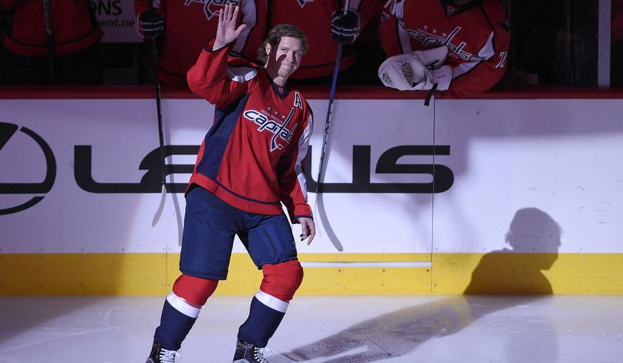 Washington Capitals center Nicklas Backstrom (19), of Sweden, waves to the crowd before an NHL hockey game against the Philadelphia Flyers, Sunday, Jan. 15, 2017, in Washington. Backstrom was honored in a pregame ceremony for being the first player in franchise history to record 500 assists. (AP Photo/Nick Wass)