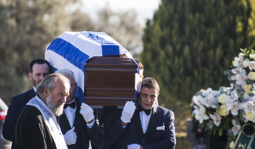The coffin of late Greek Ambassador to Brazil Kyriakos Amiridis is carried out of a church during a funeral procession, at the northern Greek city of Thessaloniki, Sunday, Jan. 15, 2017. Police have said they believe Amiridis, whose charred body was found in a car in Brazil, was killed by his wife's lover under her orders. (AP Photo/Giannis Papanikos)