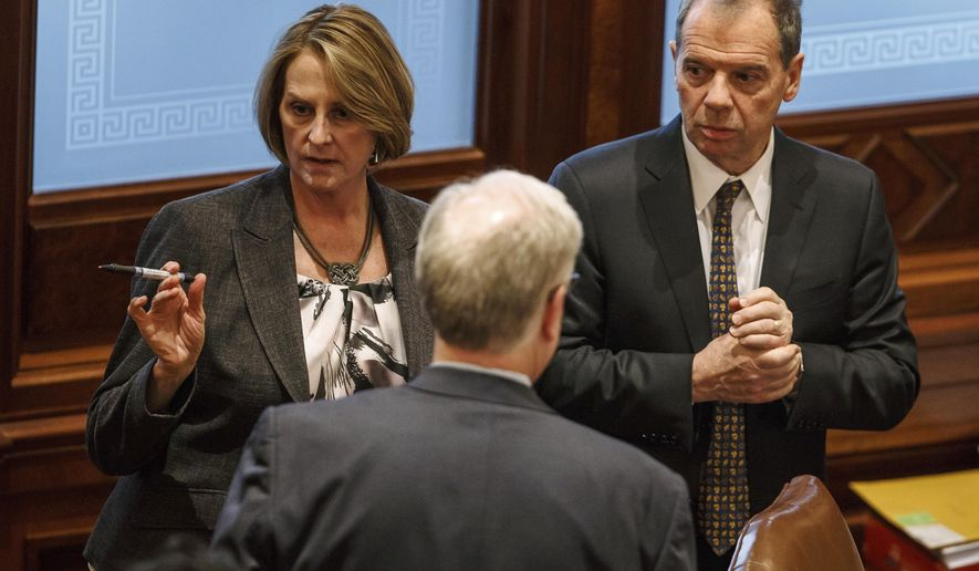 FILE - In this Jan. 9, 2017, file photo, Illinois Senate Minority Leader Christine Radogno, R-Lemont, left, talks with Illinois Senate President John Cullerton, D-Chicago, right, at the Illinois State Capitol, in Springfield, Ill. Illinois Senate leaders are hoping to move swiftly on a pledge to advance an ambitious state-budget compromise by month's end. Top Democrats and Republicans negotiated a multi-part plan to end a nearly two-year battle between Democrats and GOP Gov. Bruce Rauner. ( Justin L. Fowler/The State Journal-Register via AP, File)