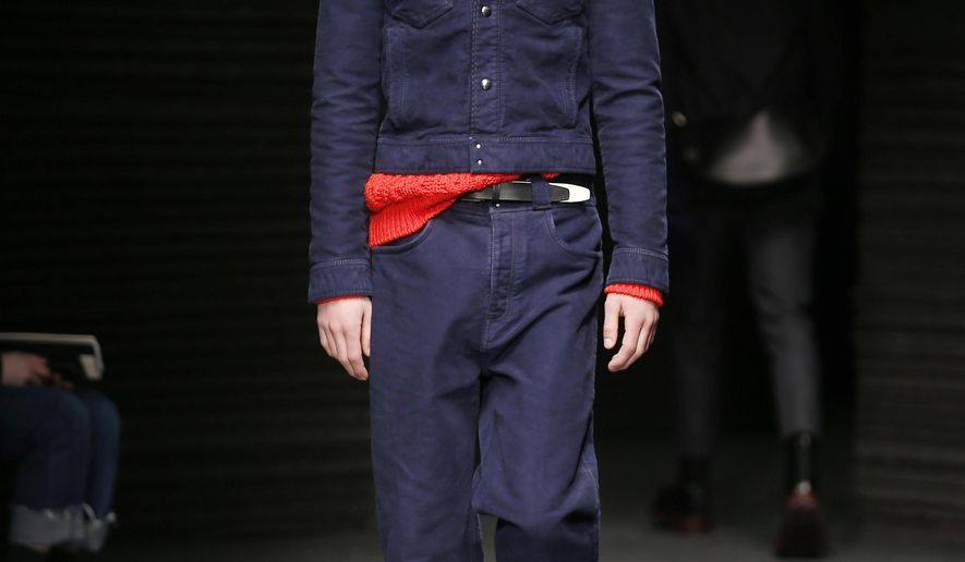 A model wears a creation for Salvatore Ferragamo men's Fall-Winter 2017-2018 collection, part of the Milan Fashion Week, unveiled in Milan, Italy, Sunday, Jan. 15, 2017. (AP Photo/Antonio Calanni)