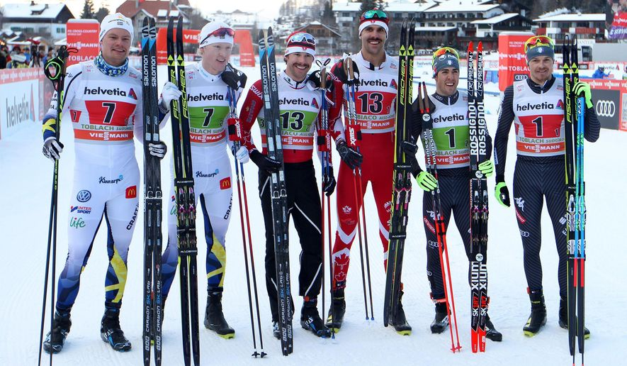 From left to right, second placed Karl-Johan Westberg and Oskar Svensson of the team Sweden 1, first placed Alex Harvey, and Len Valjas of the team Canada and third placed  Federico Pellegrino and Dietmar Noeckler of the team Italy 1 celebrate in the finish area of  the men's team sprint competition of the FIS Cross Country Skiing World Cup in Dobbiaco (Toblach), Italy, Sunday Jan. 15, 2017. (Andrea Solero/ANSA via AP)