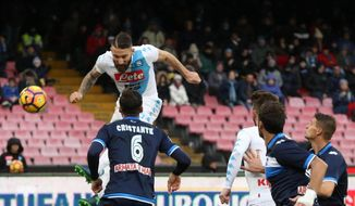 Napoli's Lorenzo Tonelli, left,  scores his side first goal during a Serie A soccer match between Napoli and Pescara at the San Paolo stadium in Naples, Italy, Sunday Jan. 15, 2017. (Cesare Abbate/ANSA via AP)