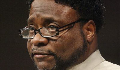 FILE - In this Sept. 26, 2010 file photo, Bishop Eddie Long speaks at New Birth Missionary Baptist Church near Atlanta. Long, a prominent pastor who led one of metro Atlanta's largest churches, died Sunday, Jan. 15, 2017, the New Birth Missionary Baptist Church said in a statement to local media outlets.  He was 63. (AP Photo/John Amis, Pool, File)