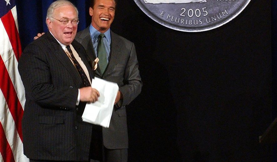FILE - In this March 29, 2004, file photo, California Gov. Arnold Schwarzenegger, right, and state Librarian Kevin Starr, smile after unveiling the design chosen for the California Quarter during ceremonies in Sacramento, Calif. Starr, California's former librarian and one of the state's premier historians, died Saturday, Jan. 14, 2017. He was 76 (AP Photo/Rich Pedroncelli, File)