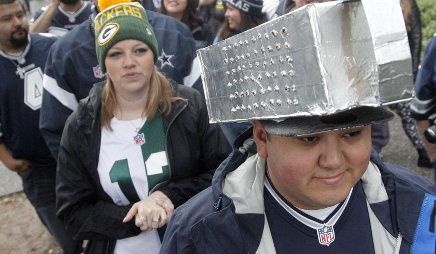 Dallas Cowboys fan Alfonso Gonzalez, right, wears a greater on his head as he waits to enter AT&T Stadium for an NFL divisional playoff football game against the Green Bay Packers, Sunday, Jan. 15, 2017, in Arlington, Texas. (AP Photo/Michael Ainsworth)