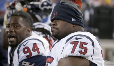 Houston Texans defenders Antonio Smith (94) and Vince Wilfork (75) watch from the sideline near the end of the team's NFL divisional playoff football game against the New England Patriots, Saturday, Jan. 14, 2017, in Foxborough, Mass. (AP Photo/Steven Senne)
