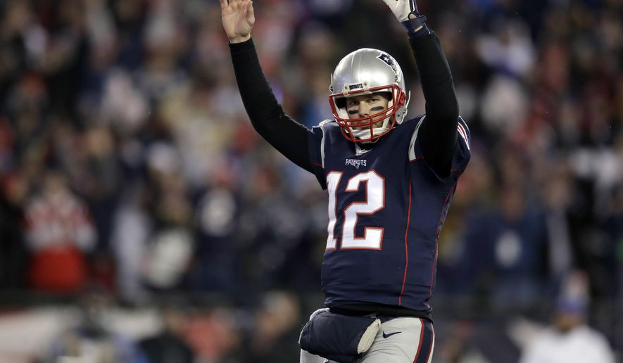 New England Patriots quarterback Tom Brady celebrates a touchdown by running back Dion Lewis during the second half of an NFL divisional playoff football game against the Houston Texans, Saturday, Jan. 14, 2017, in Foxborough, Mass. (AP Photo/Charles Krupa)