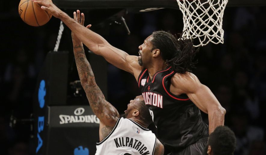 Houston Rockets' Nene Hilario, top, blocks a shot by Brooklyn Nets' Sean Kilpatrick during the first half of an NBA basketball game at the Barclays Center, Sunday, Jan. 15, 2017, in New York. (AP Photo/Seth Wenig)