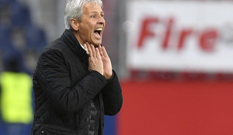 FILE - In this Thursday, Oct 20, 2016 file photo, Nice's head coach Lucien Favre shouts to his players during the Europa League group I soccer match between FC Salzburg and Nice in the Arena in Salzburg, Austria. Nice dropped valuable points in the French title race after drawing 0-0 at home to struggling Metz on Sunday, Jan. 15, 2017 a result that plays into the hands of title rival Paris Saint-Germain. (AP Photo/Kerstin Joensson, File)