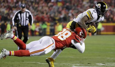 Pittsburgh Steelers wide receiver Eli Rogers is tackled by Kansas City Chiefs free safety Ron Parker, left, after making a reception during the first half of an NFL divisional playoff football game Sunday, Jan. 15, 2017, in Kansas City, Mo. (AP Photo/Charlie Riedel)