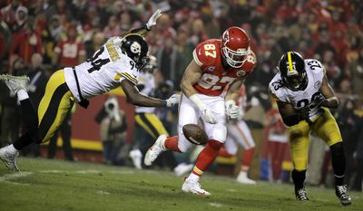Kansas City Chiefs tight end Travis Kelce (87) drops a pass between Pittsburgh Steelers defenders Lawrence Timmons, left, and Mike Mitchell during the second half of an NFL divisional playoff football game Sunday, Jan. 15, 2017, in Kansas City, Mo. (AP Photo/Charlie Riedel)