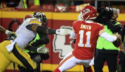 Pittsburgh Steelers defensive end Stephon Tuitt, left, pressures Kansas City Chiefs quarterback Alex Smith (11) during the first half of an NFL divisional playoff football game Sunday, Jan. 15, 2017, in Kansas City, Mo. (AP Photo/Orlin Wagner)