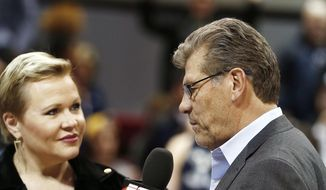 Connecticut head coach Geno Auriemma, right, gives a post game interview after winning an NCAA record 91st consecutive game, after an NCAA college basketball game against the SMU, Saturday, Jan. 14, 2017, in Dallas. Connecticut won 88-48.(AP Photo/Brandon Wade)
