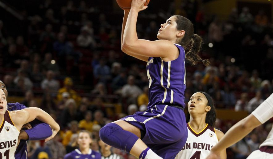 Washington guard Kelsey Plum (10) goes up for a layup in the first half against Arizona in the first half of an NCAA college basketball game in Tempe, Ariz., Sunday, Jan. 15, 2017. Arizona won 56-55. (Ben Moffat/The Arizona Republic via AP)
