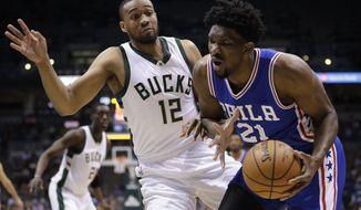 Philadelphia 76ers' Joel Embiid tries to drive past Milwaukee Bucks' Jabari Parker during the first half of an NBA basketball game Monday, Jan. 16, 2017, in Milwaukee. (AP Photo/Morry Gash)