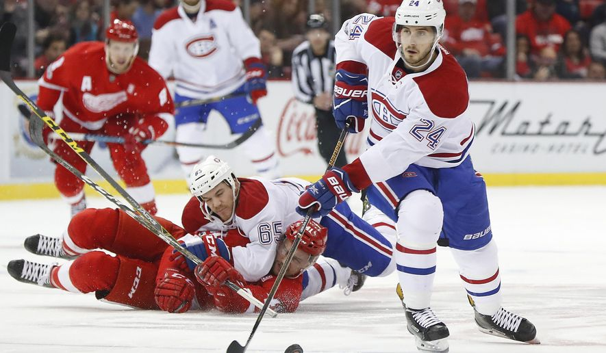 Montreal Canadiens left wing Phillip Danault (24) carries the puck against the Detroit Red Wings in the first period of an NHL hockey game Monday, Jan. 16, 2017, in Detroit. (AP Photo/Paul Sancya)