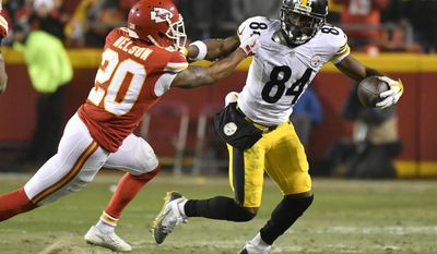 Pittsburgh Steelers wide receiver Antonio Brown (84) breaks a tackle by Kansas City Chiefs cornerback Steven Nelson (20) after making a reception during the first half of an NFL divisional playoff football game Sunday, Jan. 15, 2017, in Kansas City, Mo. (AP Photo/Ed Zurga)