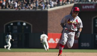 FILE - In this Sunday, Sept. 18, 2016, file photo, St. Louis Cardinals' Kolten Wong (16) heads for third on his leadoff triple during the ninth inning of a baseball game against the San Francisco Giants in San Francisco.  A year after finishing last in the National League with 35 stolen bases, St. Louis is putting an emphasis on becoming more athletic and aggressive on the basepaths this season. (AP Photo/D. Ross Cameron, File)