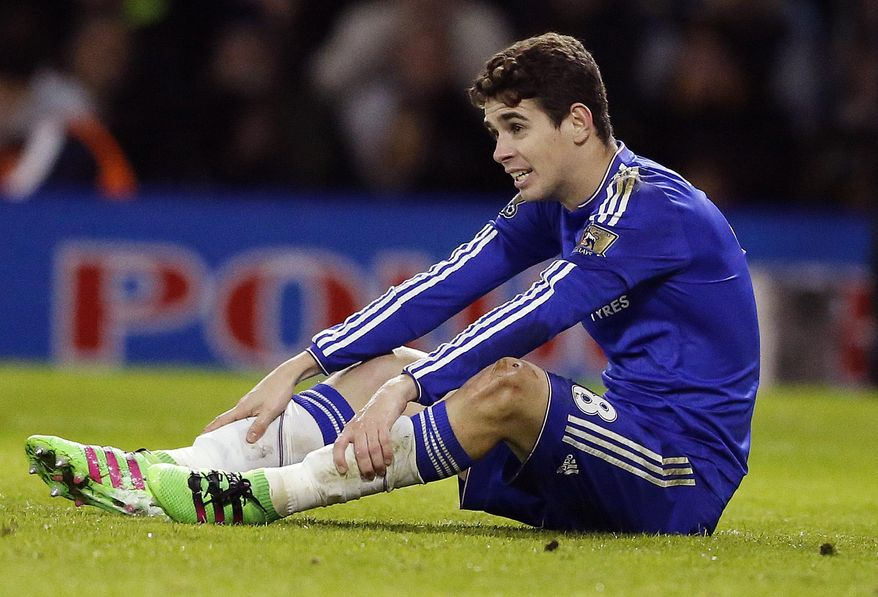 """FILE - In this Feb. 3, 2016 file photo, Chelsea's Oscar sits on the pitch during the English Premier League soccer match between Watford and Chelsea at the Vicarage Road stadium in London. The governing body of Chinese soccer plans a series of measures in response to what is termed """"irrational"""" spending by clubs on transfer fees and player salaries, amid concerns that foreign stars are crowding out local talent and harming the country's goal of becoming a global force in the sport. Shanghai Shenhua said it paid an $11 million transfer fee to Argentina's Boca Juniors for Teves. Oscar was purchased from Chelsea, and Brazilians Hulk, Ramires, Alex Teixeira and Paulinho, Colombian striker Jackson Martinez and Argentine forward Ezequiel Lavezzi also joined the league. (AP Photo/Frank Augstein, File)"""