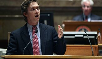 FILE- In this March 11, 2013 file photo, Colorado state Sen. Mike Johnston, D-Denver, argues in favor of one of several gun control bills before the Colorado Legislature at the State Capitol in Denver. Johnston plans to officially announce that he is running for Colorado governor on Tuesday, Jan. 17, 2017. (AP Photo/Brennan Linsley, File)