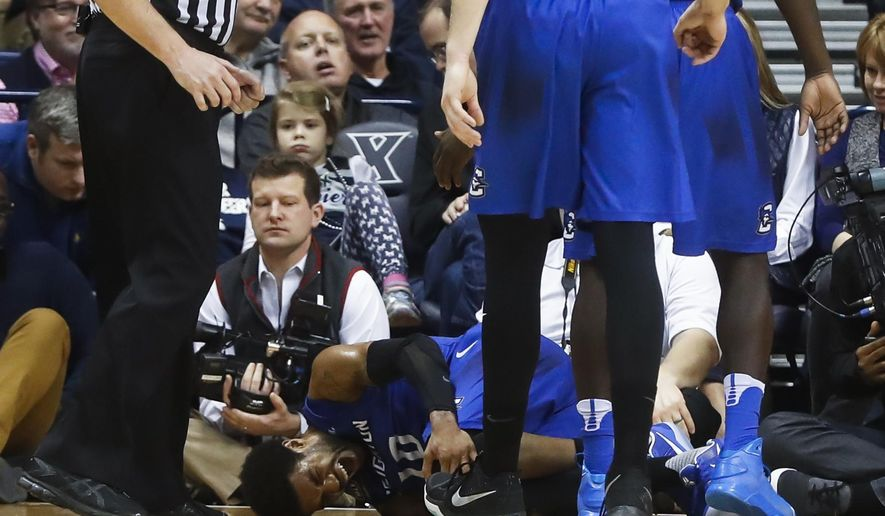 Creighton's Maurice Watson Jr. (10) winces in pain after injuring his knee in the first half of an NCAA college basketball game against Creighton, Monday, Jan. 16, 2017, in Cincinnati. (AP Photo/John Minchillo)