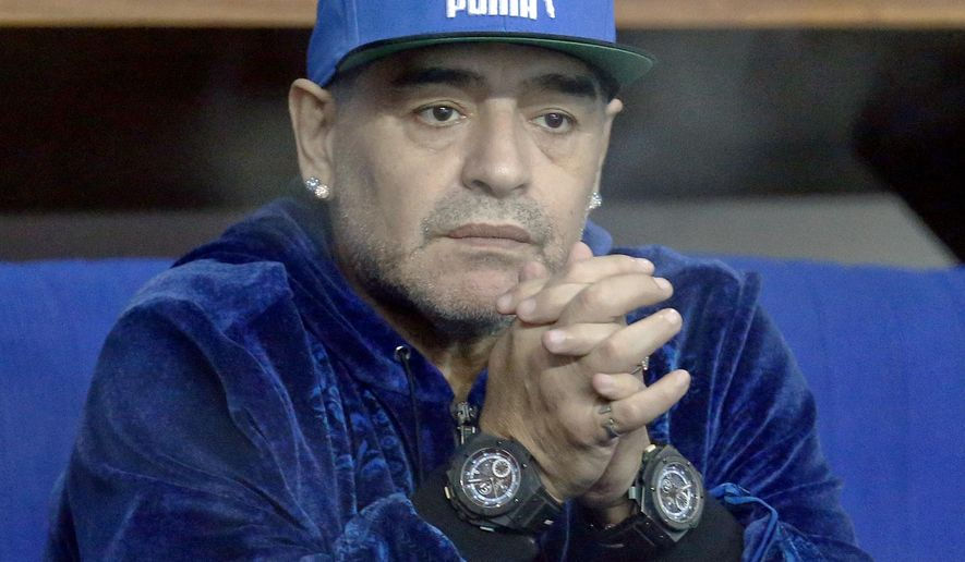 FILE - A Friday, Nov. 25, 2016 file photo showing Argentina's soccer legend Diego Maradona watching the Davis Cup finals tennis singles match between Croatia's Marin Cilic and Argentina's Federico Delbonis in Zagreb, Croatia. Former Napoli star Diego Maradona is in talks to work with the Serie A side, where he is still idolized nearly 27 years after leaving the club. Maradona, who is in Naples for a theatrical event on Monday celebrating the club's first title win, met with Napoli President Aurelio de Laurentiis on Saturday night, Jan 14, 2017. (AP Photo/Darko Bandic, File)