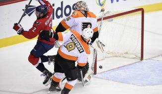 FILE - In this Jan. 15, 2017, file photo, Washington Capitals defenseman Matt Niskanen (2) scores a goal against Philadelphia Flyers goalie Steve Mason (35) as Flyers defenseman Ivan Provorov (9), of Russia looks on, during the third period of an NHL hockey game in Washington. With their bye week under way, the Flyers have four days to stew over their losing ways. (AP Photo/Nick Wass, File)
