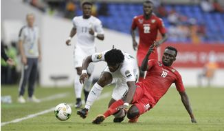 Ivory Coast's Franck Yannick Kessie, left, is challenged by Togo's Atakora Lalawewe, right, during the African Cup of Nations Group C soccer match between Ivory Coast and Togo at the Stade de Oyem in Gabon Monday Jan. 16, 2017. (AP Photo/Sunday Alamba)