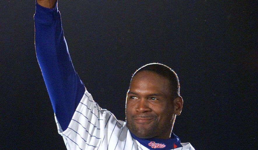 ADVANCE FOR WEEKEND EDITIONS JAN. 14-15 - FILE - In this April 6, 2001, file photo, Montreal Expos' Tim Raines acknowledges applause from fans as he is presented before the Expos home opener in Montreal. Raines could be elected into the Baseball Hall of Fame when voting is announced Wednesday, Jan. 18, 2016. (AP Photo/Ryan Remiorz, File)