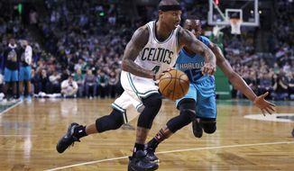 Boston Celtics guard Isaiah Thomas (4) drives to the basket past Charlotte Hornets guard Kemba Walker (15) during the first quarter of an NBA basketball game in Boston, Monday, Jan. 16, 2017. (AP Photo/Charles Krupa)