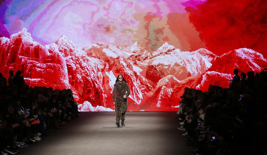A model wears a creation for Etro men's Fall-Winter 2017-2018 collection, part of the Milan Fashion Week, unveiled in Milan, Italy, Monday, Jan. 16, 2017. (AP Photo/Antonio Calanni)