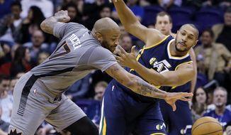 Phoenix Suns forward P.J. Tucker (17) and Utah Jazz center Boris Diaw battle for the loose ball in the first quarter during an NBA basketball game, Monday, Jan. 16, 2017, in Phoenix. (AP Photo/Rick Scuteri)