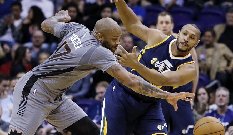 Phoenix Suns forward P.J. Tucker (17) and Utah Jazz center Boris Diaw battle for the loose ball in the first quarter during an NBA basketball game, Monday, Jan. 16, 2017, in Phoenix. (AP Photo/Rick Scuteri)